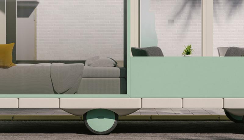 Trozo de imagen en la que se ve una cama y unos sillones en un coche