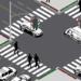 Una baliza semafórica empotrada en el pavimento advierte a los peatones que miran el móvil al cruzar