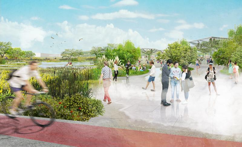 Plaza con nebulizadores de agua, personas paseando y un carril bici